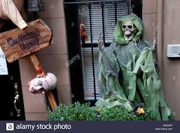 halloween display of skeletons on outside of house in new york