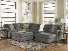 bright city space dark gray couches grey couches and blue accents