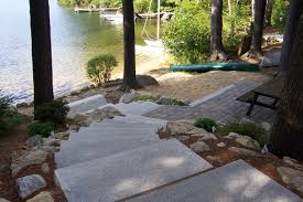 paver patio with granite steps entrance to lake idea home