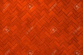 texture of light red color paint weave wall for background stock