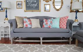 furniture transitional living room with upholstered grey tufted