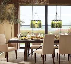 gorgeous dining room lighting installed above simple wooden dining
