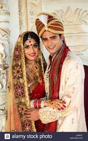 indian wedding groom indian and groom in traditional wedding dress stock photo