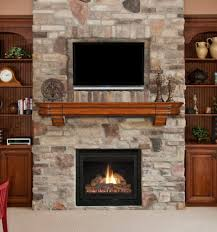 television over fireplace black steel fireplace with floating brown wooden shelf also
