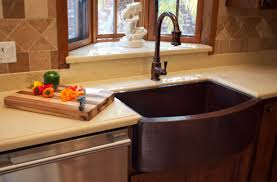Kitchen Cabinet Features Interior Dark Apron Sinks With Brass Arched Faucet And Wooden