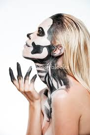 profile of woman with intimidating halloween makeup over white