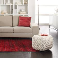 loveseat recliner in spaces contemporary with floor pouf next to
