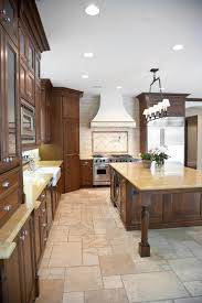 48 luxury dream kitchen designs worth every penny photos light stone tile flooring supports dark natural wood surfaces and yellow marble countertops in this kitchen
