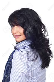 smiling business woman with hairstyle with bangs and curly hair
