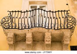 medieval architecture wrought iron balcony shutters la bastide