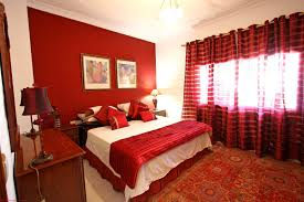 romantic bedroom decoration and design for couple with red theme