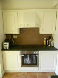 Spray Paint Kitchen Cabinets by Spray Painting Kitchen Cabinets Favorite Places Spaces Cabinet