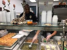 arlington officers serve thanksgiving lunch goodman