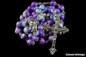 purple rosary catholic rosary purple blue white flower