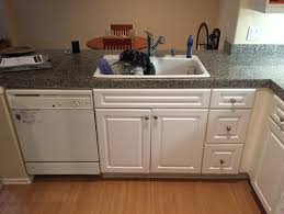 white sink black countertop flooring for dark countertops white cabinets beige walls