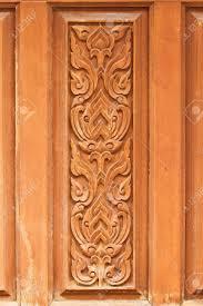Wooden Door Thai Delicate Pattern Carved On Temple Wooden Door Stock Photo
