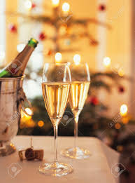 two glasses of sparkling wine for christmas party stock photo