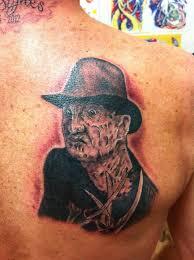 very nice grey freddy krueger tattoo on back shoulder by jayblum
