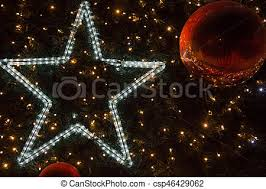bright star lights christmas decorated christmas tree with a bright star shining lights stock