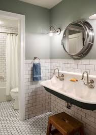 white subway tile bathroom ideas bathroom with green walls white subway tiles and antique vanity