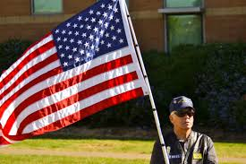 A American Flag Pictures File A Member Of The Patriot Guard Riders Holding An American Flag