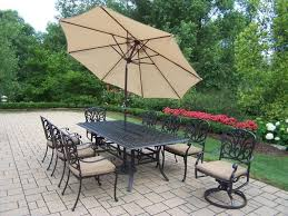 Cast Iron Patio Table And Chairs by Patio 7 Patio Dining Set With Umbrella Wooden Patio Furniture