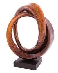 stohans showcase unique wood sculptures bronze sculptures