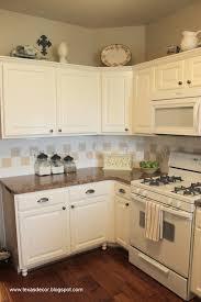 antique white kitchen cabinets with white appliances antique