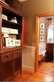 gray walls with wooden trim what if the trim was darker wood
