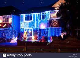 semi detached houses decorated with christmas lights in surrey