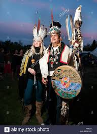 a couple in traditional native american or indian headdresses
