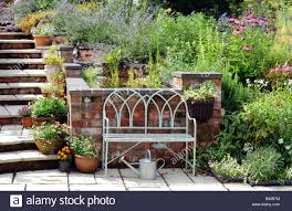 garden bench in traditional cottage garden setting worcestershire