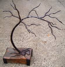 iron with elm floral fruit plantlife sculpture by artist adrian