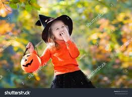 little witch costume playing autumn stock photo 460107253