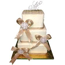 ribbon and bows 1296 3 tier wedding cake with gold ribbon bows abc cake shop