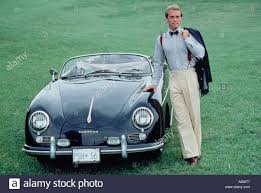 vintage porsche blue stylish young man standing outdoors beside classic vintage porsche