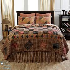 brown country style bedroom with plaid patchwork primitive bedding