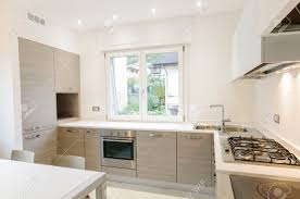 Modern Kitchen Interior Modern Kitchen Interior With Wooden Cabinets And White Table Stock