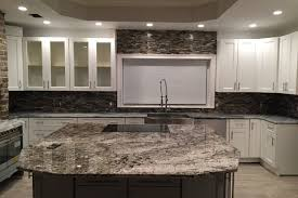oversized kitchen islands white tiger granite caps the oversized kitchen island emrichpro