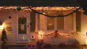 the grinch christmas lights neighbors upset after thieves christmas light projectors