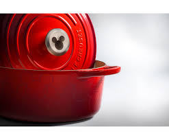 le creuset beauty and the beast le creuset u0026 disney u0027s mickey themed cookware will make your