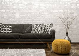 salon canapé noir intérieur moderne de salon avec canapé noir tapis et pouf tricoté
