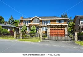 Front Yard Metal Fences - residential house wide garage landscaped front stock photo