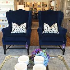 Blue Chairs For Living Room by Navy Blue Wingback Chair With Black Painted Legs Design