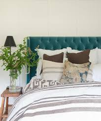 blue velvet tufted wingback headboard with white and gray striped