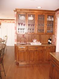 glass door rustic cherry wood pantry cabinet aside dining nook