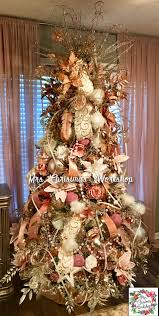 large brown christmas tree gold and pinks on the christmas tree with large pearl garland and
