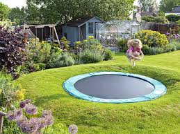 sunken trampoline part of a family garden design find out more