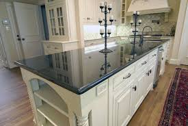 white kitchen cabinets with green granite countertops black granite countertops styles tips infographic