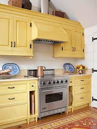 what color goes with yellow kitchen cabinets trendspotting colorful kitchen cabinet colors run to radiance